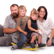 Happy family resting on a white background — Stock Photo