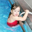 Happy little girl swimming in the pool — Stock Photo #32735371