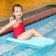 Happy little girl swimming in the pool — Stock Photo
