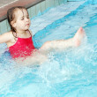 Happy little girl swimming in the pool — Foto Stock