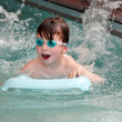 Stock Photo: Boy swimming in a pool.