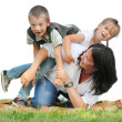Funny family playing on the grass isolated on a white background. — Stok fotoğraf