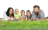 Happy family on the grass isolated on a white background. — Stock Photo