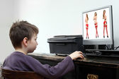 Little boy looking at computer with adult content — Stock Photo