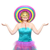 Pretty showgirl with golden mask and colorful sombrero — Stock Photo