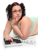 Overweight woman with a weighing machine. — Stock Photo