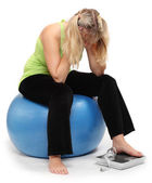 Depressed overweight woman on a weighing machine. — Stock Photo