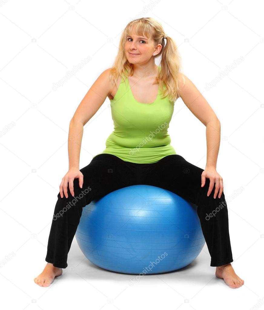 naked woman sitting on gym ball