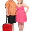 Funny obese couple going to holidays. — Stock Photo #32751761