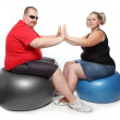 Overweight woman and man exercising sitting on blue fitness ball — Stock Photo #32751911