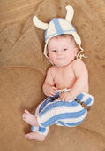 Little viking in handmade knitted costume. — Stock Photo