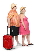 Funny obese couple going to holidays. — Stock Photo
