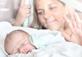 Newborn baby boy sleeping in a incubator. — Stock Photo