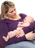 Young mother with her screaming baby. — Stock Photo