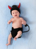 Fashion photo of a cute baby with funny knitted costume for carnival — Stock Photo