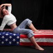 Happy american girl on a flag. Independence day concept. — Stock Photo #32783783