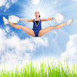 Young cheerleader girl jumping — Stock Photo