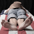 Stock Photo: Deadly cowboy on americflag. Economic crisis metaphor.