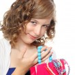 Happy girl with her christmas gift, costume jewelry — Stock Photo #32784495