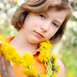 Girl with dandelion necklace — Stock Photo