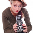 Photographer with camera dressed tropical suit — Stock Photo