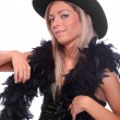 Stock Photo: Beautiful showgirl in retro costume with cowboy hat and black boa.