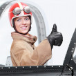 Beautiful girl in a cockpit of a vintage plane.  — Stock Photo