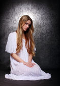 Romantic style picture young beautiful girl dressed in white shirt tunic with glory (halo) — Stock Photo