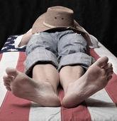 Deadly cowboy on a american flag. Economic crisis metaphor. — Stock Photo