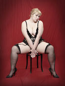 Retro style picture of the overweight woman dressed in black lingerie — Stock Photo