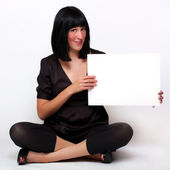 Beautiful woman holding empty white board — Stock Photo
