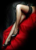 Low key lighting studio shot young beautiful Gothic woman legs — Stock Photo