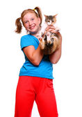 Young girl playing with cat. — Foto Stock