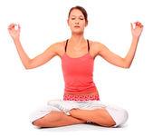 Shot of a teenage girl in yoga pose. — Foto de Stock