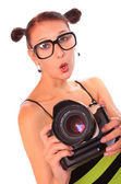 Young photographer with professional camera — Stock Photo