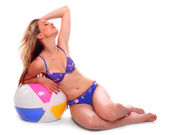 Young woman in swimsuit with ball — Stock Photo
