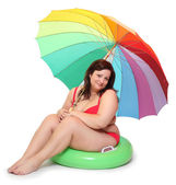 Funny obese woman on the beach. — Stock Photo