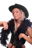 Beautiful showgirl in retro costume with cowboy hat and black boa. — Stock Photo