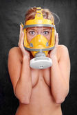 Naked woman in yellow gas mask. Environmental metaphor. — Stock Photo