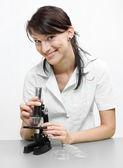 Female scientist with microscope. — Stock Photo