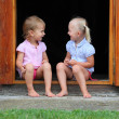 Funny kids in the doorway to an rural house. — Foto de Stock