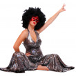 Stock Photo: Showgirl with red mask and afro hair-style dressed in retro costume.