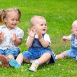 Happy children on green meadow. — Stock Photo