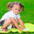 Little indian girl on a green meadow — Stock Photo