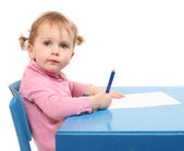 Little scholar in the school desk. — Stockfoto