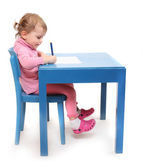 Little scholar in the school desk. — Stock fotografie