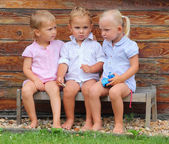 Funny siblings on a rural bench. — Stock Photo
