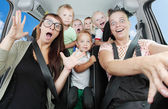 Crazy mothers with her children riding to holidays. — Stock Photo