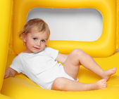 Children playing on a inflatable trampoline. — Stock Photo