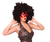 Showgirl with red mask and afro hair-style dressed in retro costume. — Stock Photo